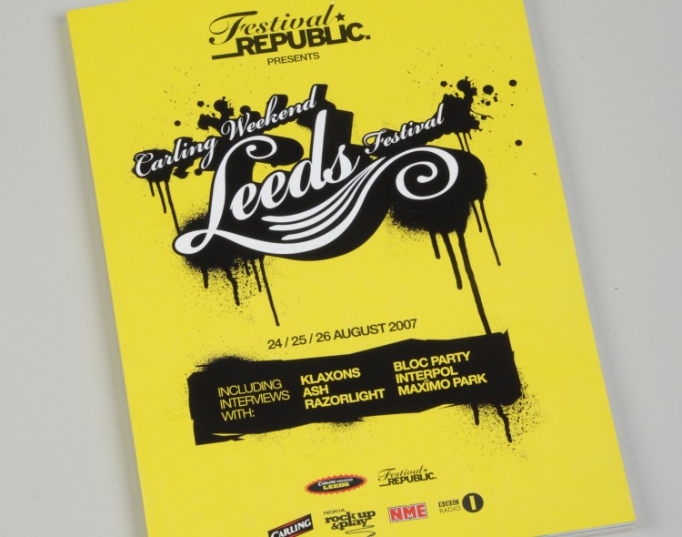 Yellow booklet with 'Festival Republic presents Leeds Festival' written in black and white on the front
